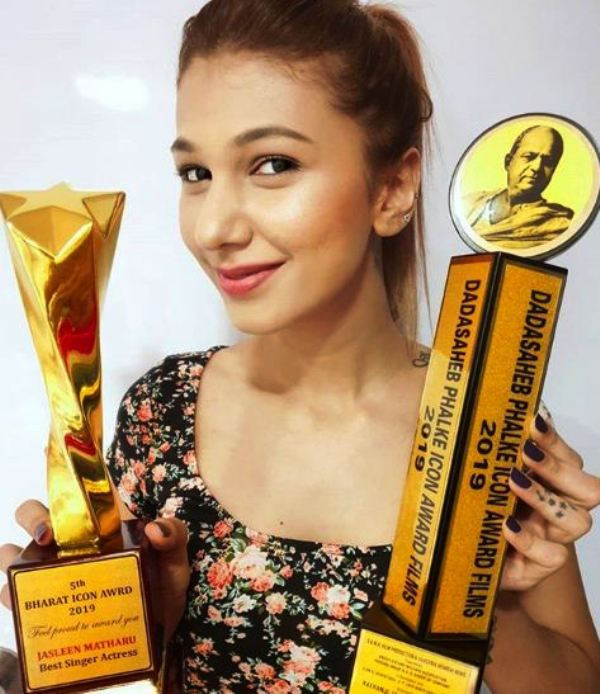 Jasleen Matharu Posing With Her Awards