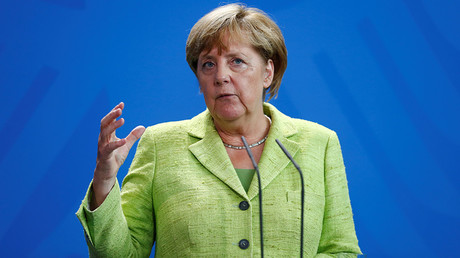 'Germany's change of stance on migrant policy tailored to squeeze Merkel through to new term'