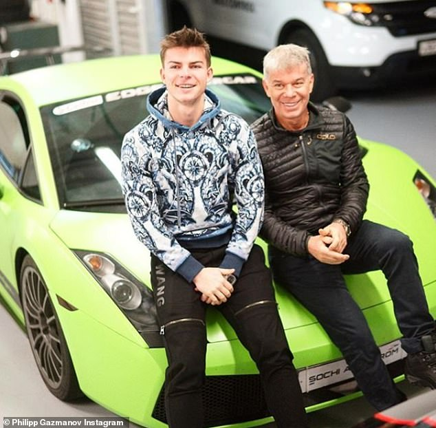 Philipp Gazmanov is seen with his father, Russian popstar Oleg Gazmanov, as they pose in front of a fast car, enjoying a life of luxury which he frequently shares on Instagram