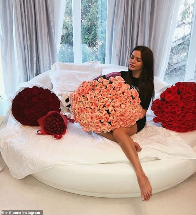 Anna Milyavskaya is seen celebrating her 22nd birthday in Moscow, lying on a plush day bed surrounded by luxurious bouquets of roses in another snap shared with her 11,600 followers