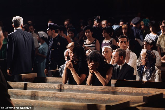 Former first lady Jacqueline Kennedy and her sister, Princess Lee Radziwill, pray in St. Patrick