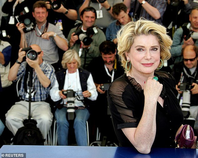 Deneuve smiles during a photo call at the 58th Cannes Film Festival May 12, 2005