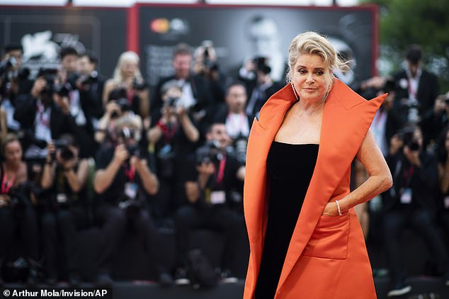 Deneuve poses for photographers upon arrival at the premiere of the film