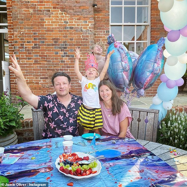 Joyful: Jamie and Jools Oliver have celebrated their youngest son