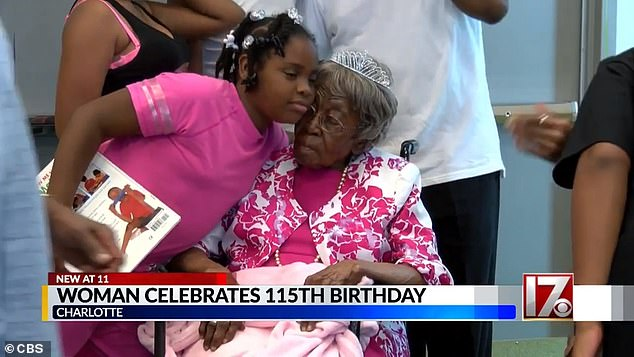 Hester celebrating her big day with one of her 200 great-grandchildren. Hester has lived twice as long as her husband John, who died aged 57 in 1963