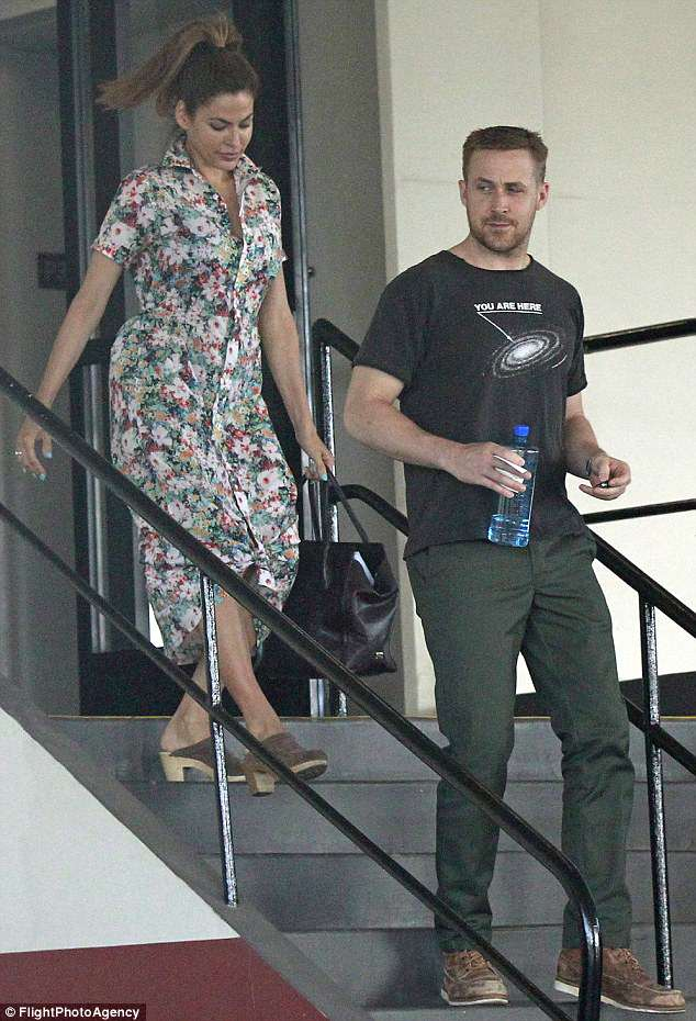 Step lively: Ryan Gosling and Eva Mendes, together since 2011, were photographed this Tuesday stepping out as a duo in Los Angeles