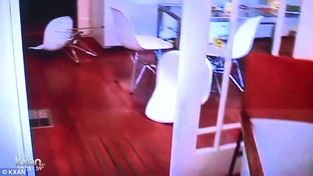 This picture is a video grab of the crime scene that saw furniture ending up on its side