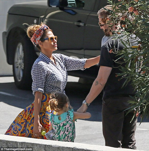 Bonding time: Eva Mendes was seen smiling from ear-to-ear as she enjoyed a day at the park with longtime partner Ryan Gosling and their two children in Los Angeles on Tuesday