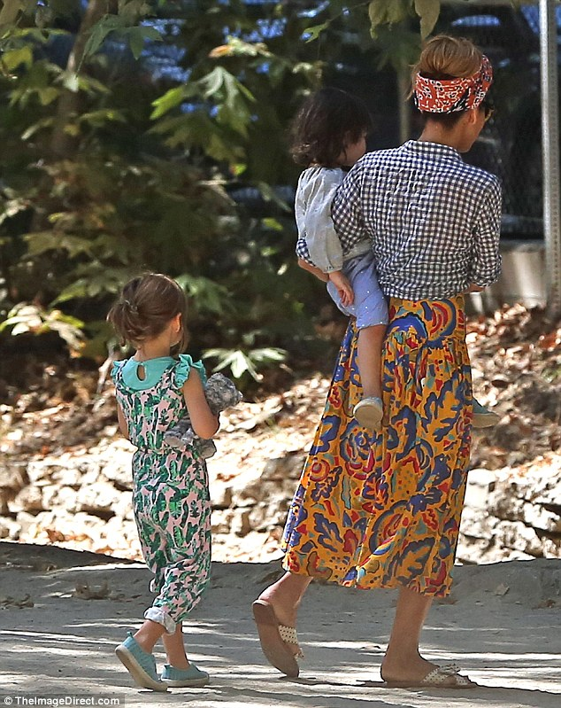 Bonding: Eva carried the youngest daughter while her eldest walked behind them