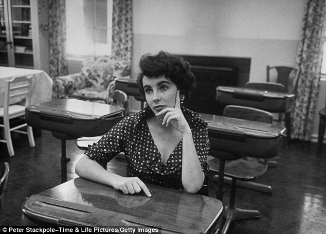Studious: Elizabeth Taylor sits at a desk in a classroom at Hollywood