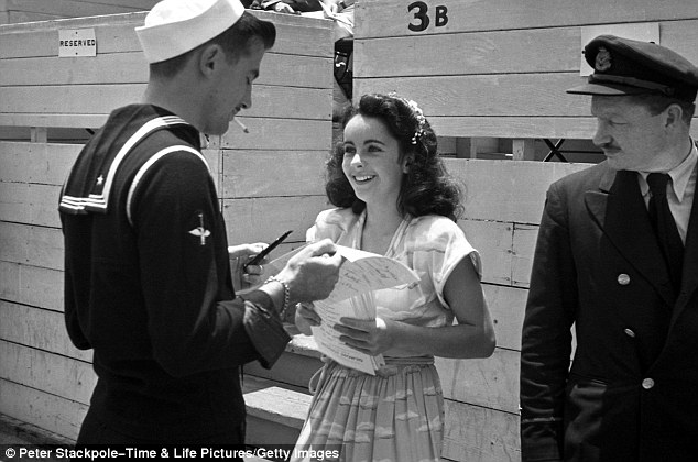 Adored: In 1945, at age 13 and already a veteran of five films, Elizabeth Taylor signs autographs during a charity cricket match at Los Angeles