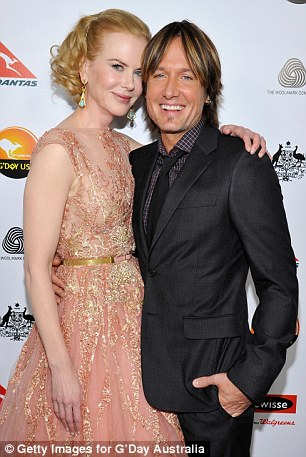 In love: Kidman and Urban cuddle up on the red-carpet at last week