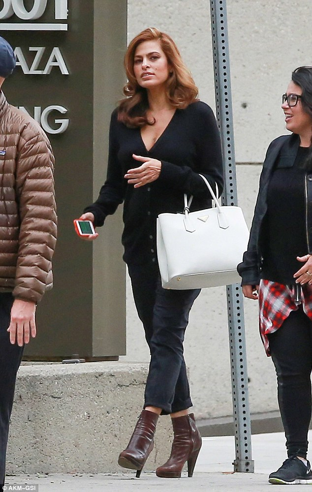 Staying home: Eva, 40, has refused to hire a nanny and has revealed in recent interviews that she is exhausted; here she is s pictured out in LA on November 3