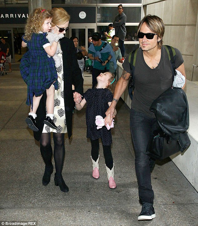 Family matters: Nicole and Keith (pictured with their daughters at LAX on July 2, 2014) prefer to live away from the Hollywood spotlight in Nashville