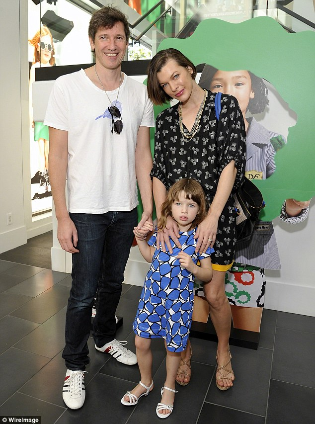 Family of four: Paul, Milla and Ever pictured together in March 2012