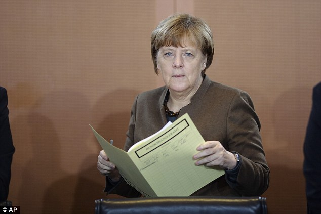 Merkel, pictured today arriving at the German government