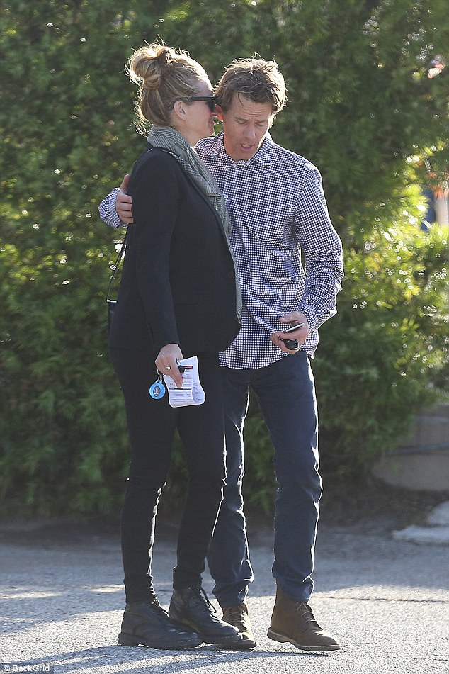 Stepping out: Julia Roberts was seen getting cozy with her husband Daniel Moder as they ambled about outdoors in Los Angeles on Saturday