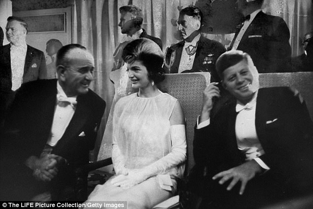 At the White House, John and Jackie hosted raucous and often raunchy parties with friends in the family quarters or retreats where they smoked and drank for hours (The first lady chatting with Vice President Lyndon Johnson)